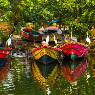 Bootjes in het water bij Negril, Jamaica