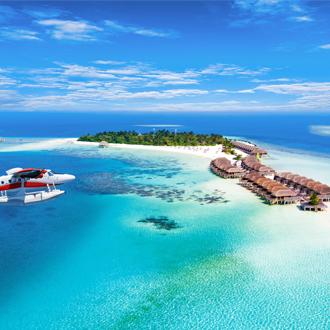 Watervliegtuig en waterhuisjes op de Malediven