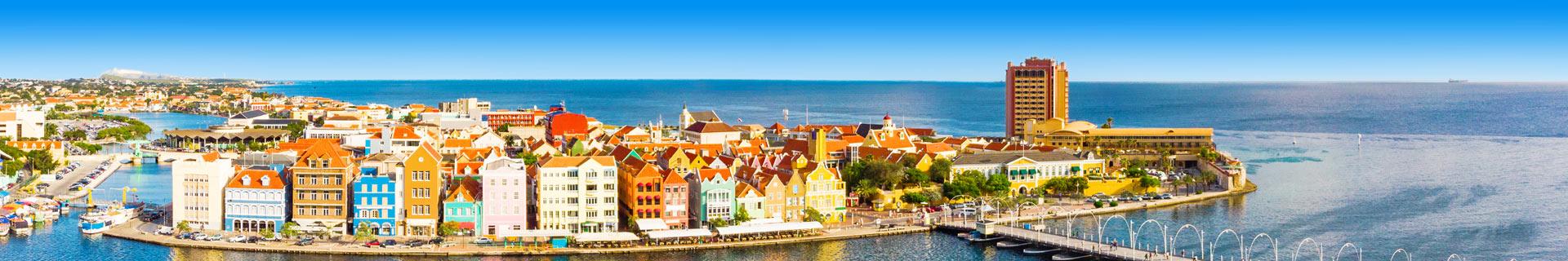 Kan ik op vakantie naar Curacao / Aruba?