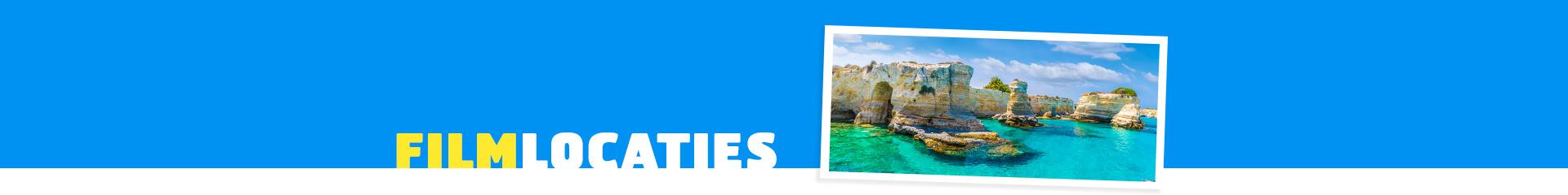De rotsen van Puglia met helderblauwe zee